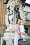 Woman sitting in loggia dei lanzi in florence Stock Images