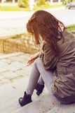 Woman sitting lonely Royalty Free Stock Photo