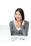 Woman sitting looking at her laptop computer Royalty Free Stock Image