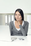 Woman sitting looking at her laptop computer Stock Photos
