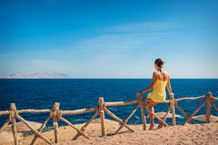 Woman sitting looking at the sea Royalty Free Stock Photos