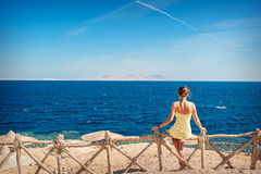 Woman sitting looking at the sea Royalty Free Stock Photo