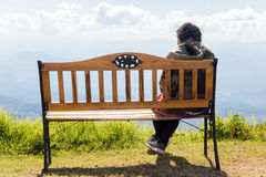 Woman sitting on the lookout. Romantic view from bench on top of hill Royalty Free Stock Images