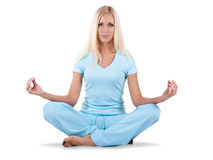 Woman is sitting in the lotos position Stock Photos