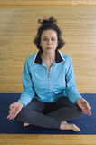 Woman Sitting In Lotus Position Stock Images