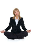 Woman sitting in lotus position Royalty Free Stock Image