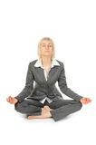 Woman sitting in lotus position isolated on white Stock Images