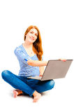 Woman sitting in a lotus position with a laptop Royalty Free Stock Photography