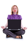 Woman sitting in lotus position with laptop Royalty Free Stock Image