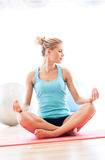 Woman sitting in lotus position Stock Photo