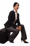 Woman sitting on luggage Royalty Free Stock Images