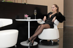 Woman sitting in luxury interior Stock Images