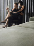 Woman Sitting On Man's Lap Stock Images