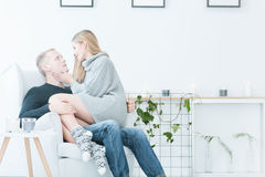 Woman sitting on man`s laps Royalty Free Stock Photo