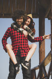 Woman sitting on man's shoulders stock images