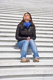 Woman sitting on the marble steps Royalty Free Stock Images