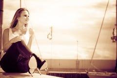 Woman sitting on marina Royalty Free Stock Photography