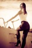Woman sitting on marina Royalty Free Stock Photos