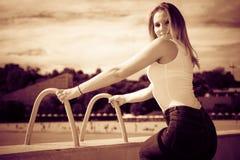 Woman sitting on marina Royalty Free Stock Photo