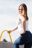 Woman sitting on marina Stock Photos
