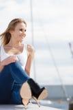 Woman sitting on marina Stock Photo