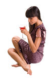Woman sitting with martini glass in hand Royalty Free Stock Photos