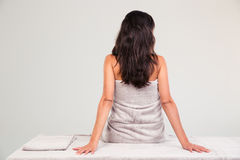 Woman sitting on massage lounger Stock Images