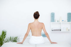 Woman sitting on massage table Royalty Free Stock Image