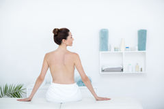 Woman sitting on massage table. In medical office Royalty Free Stock Images
