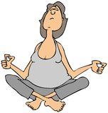 Woman sitting and meditating Stock Images