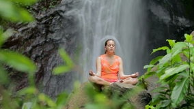 Woman sitting in meditation stock video footage