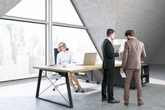 Woman sitting and men talking in a CEO office with triangular wi. Woman sitting and men talking in a CEO office with a large triangular window, a large table Stock Photography