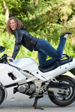 Woman sitting on a motorcycle Stock Photo