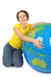 Woman sitting near big inflatable globe Royalty Free Stock Images