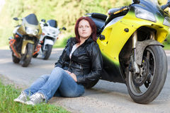 Woman sitting near bike Royalty Free Stock Images