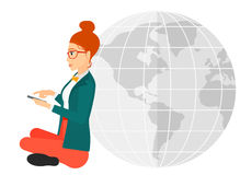 Woman sitting near globe Stock Photography