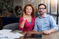 Woman sitting near her partner and pointing forward Royalty Free Stock Images