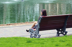 Woman sitting near the lake Royalty Free Stock Photos
