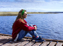 Woman sitting near the lake Royalty Free Stock Images