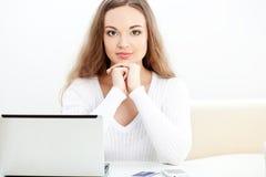 Woman sitting near laptop Royalty Free Stock Photo