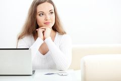 Woman sitting near laptop Stock Photo