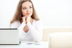 Woman sitting near laptop Stock Photo