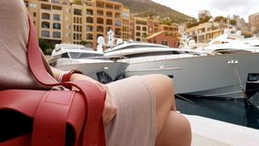 Woman sitting near pier, opened purse as concept of pickpocketing in resorts. Stock photo stock photos