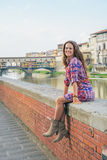 Woman sitting near ponte vecchio in florence Royalty Free Stock Image