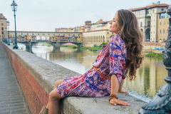 Woman sitting near ponte vecchio in florence Stock Photography