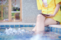 Woman sitting near pool Stock Image