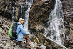 Woman sitting near Siklawa waterfall in Poland Royalty Free Stock Image