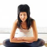 Woman sitting near a window. Girl sitting near a window Royalty Free Stock Photos