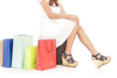 Woman sitting next to shopping bags Royalty Free Stock Images