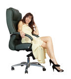 Woman sitting on office armchair Royalty Free Stock Image